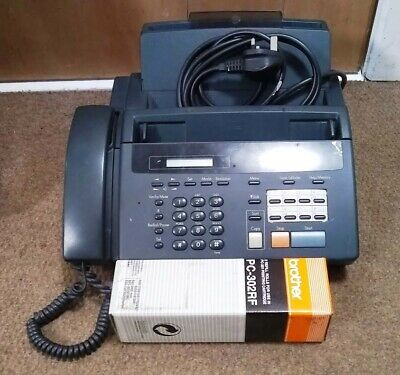 Brother 920 Fax machine and 2 rolls of paper