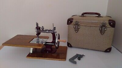 vintage 1950s essex miniature sewing machine with carry case.