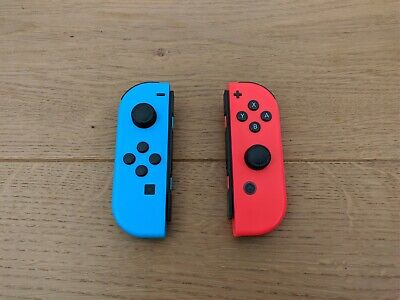 Nintendo Switch Joy-Con Neon Red / Neon Blue Pair 0002 Great Condition