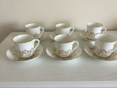 vintage white and gold 6 tea cups and saucers