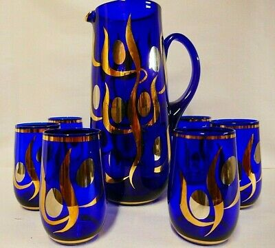 Large and lovely cobalt blue water jug and six glasses with hand painted gilding