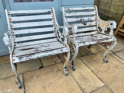 Pair of vintage cast iron garden chairs. Lovely detail. Very heavy.