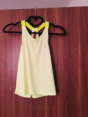 girls marks and spencer 8-9 Sports Vest , Lovely  Condition.