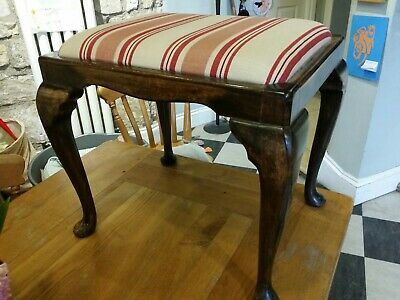Vintage Stool with fine upholstery.