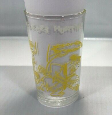 1962 jelly/jam glass featuring Fred and the Flintstones playing Golf