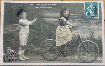 1909 Hand Colored Realphoto Fantasy PC: Girl on Bicycle