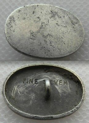 Collectable Oval 20 mm Long Button with Loop. FINE SILVER Stamped to the back