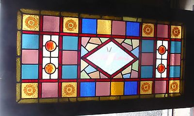 Antique stained glass window featuring bird