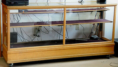 Solid Oak antique store display case with plate glass top, orig front, and sides