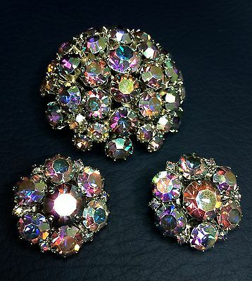 VINTAGE WARNER DOMED BROOCH AND EAR CLIPS, AURORA BOREALIS ON SILVER METAL
