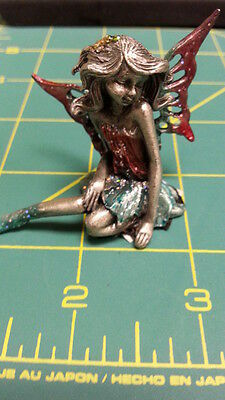 Fairy Pewter Figurine - Fairy sitting down - blue skirt and burgundy top