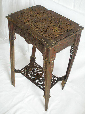 Antique wooden hand carved table unique craftsmanship and rich ornamentation