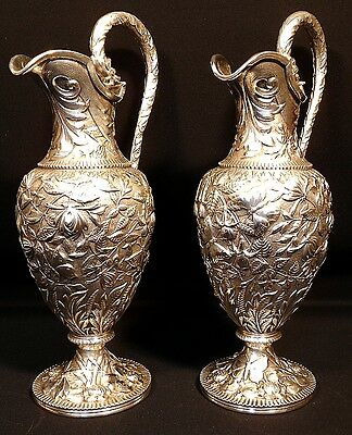 A magnificent pair of repousse sterling silver water pitchers, S. Kirk & Son, MD