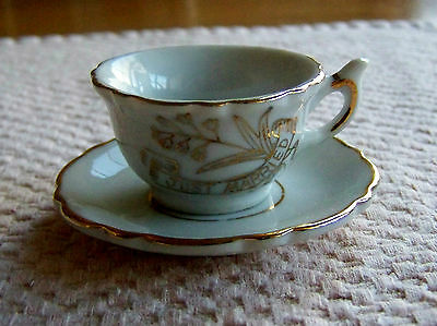 """JUST MARRIED"" MINIATURE CUP & SAUCER. GOLD TRIM ON WHITE PORCELAIN. (3373)."