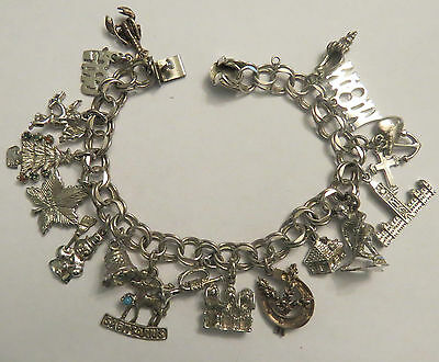Cb-54 Vintage Sterling Silver Charm Bracelet With 17 Charms. Weighs 39.50 Grams