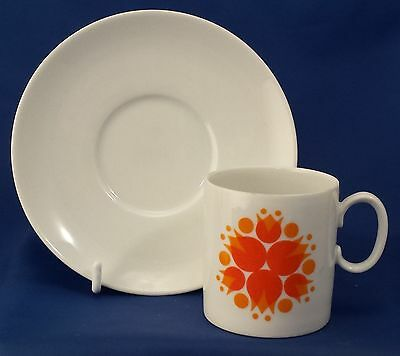 A Thomas 'pinwheel' Orange Tea Cup And Saucer