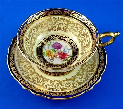 Gorgeous Floral Center with a Gold and Cobalt Paragon Tea Cup and Saucer Set
