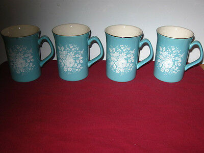 ROYAL WINTON-GRIMEWADES TURQUOISE MUGS DECORATED WITH WHITE ROSES (4)