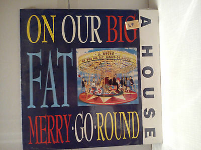 A House - On our big fat Merry go round                ............Vinyl