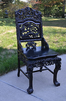 Antique Chinese Rosewood Chair With High Relief Carving