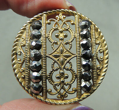 BRASS OPENWORK BUTTON W/ CUT STEELS    METAL