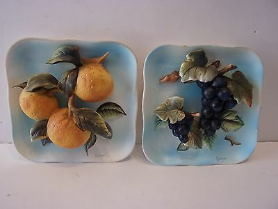A PAIR OF 3D FRUIT WALL PLAQUES...... GRAPES ORANGES ENESCO?