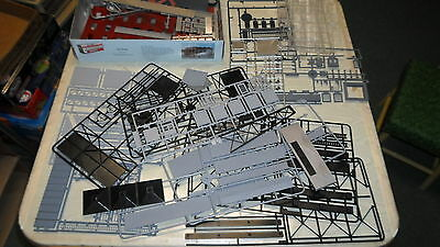 LARGE LOT OF HO BUILDING PARTS.  MOSTLY FROM WALTHERS KITS