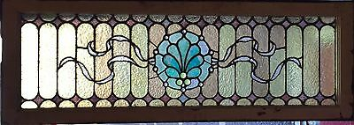 Jeweled center stained glass window