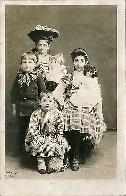 Four Charming Children With Antique Dolls & Original Vintage Real Photo Postcard