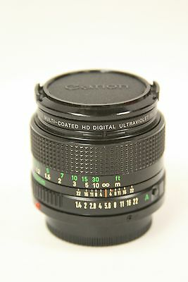 Canon 50mm f1.4 FD manual focus lens with filter and caps