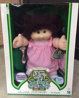25th anniversary Cabbage Patch girl doll brown hair green eyes and tooth