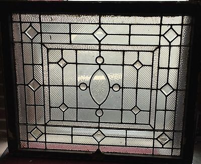 Turn of the century jeweled and beveled stained glass window