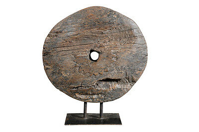 Old wheel on base timber object India Luxury Park