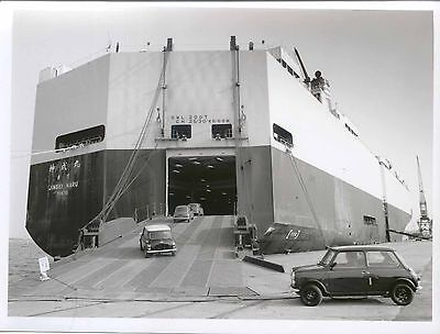 Mini cars being driven onto a boat bound for Tokyo b/w Press Photo circa 1990s