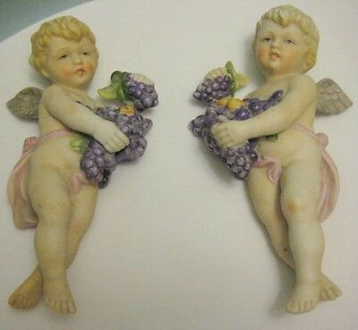 Old Pair Beautiful Bisque Napco Cupid Dolls w/wings holding Grapes wall hangings