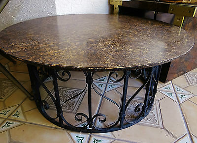 """1970's 38"""" Round Coffee Table Wrought Iron Base Dark Knotted Wood Formica Top"""