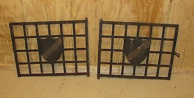 Pair Antique Architectural Wrought and Cast Iron Window Gates with Shield