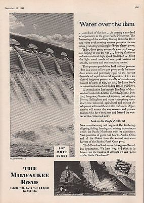 1944 Milwaukee Road Ad: Water Over the Dam the Grand Coulee Dam