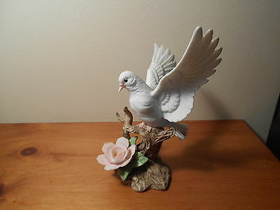 Porcelain Dove Figurine with pink flower