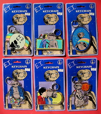 E.T. 1982 six (6) different large giant keychains on orig cards