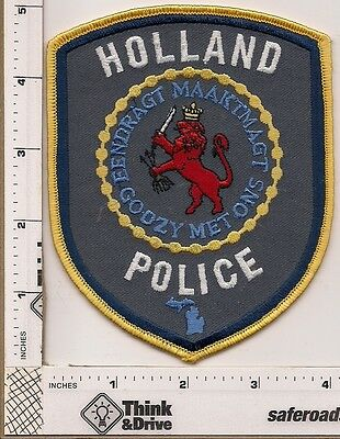 Holland Police.  Grey background. yellow thread edge.Michigan.