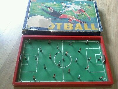 Vintage table football game metal goals spring action