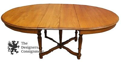 Early 20th Century Antique Round Oak Table Arts + Crafts Carved Spindle Casters
