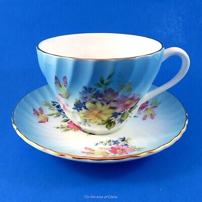 Colorful Floral Bouquet on Blue Swirl Crown Staffordshire Teacup and Saucer Set