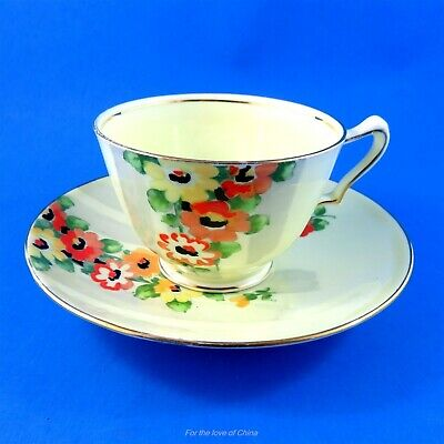 Bright Red, Orange & Yellow Flower Crown Staffordshire Teacup and Saucer Set