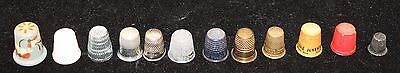 Collection of 12 Thimbles Plastic Wood Metal