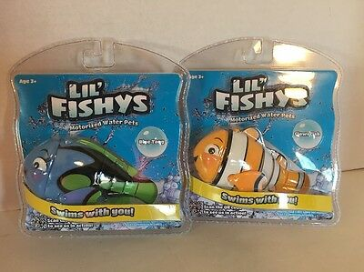Set of 2  LIL' Fishys Motorized Water Pets Blue Tang & Clown Fish NWT