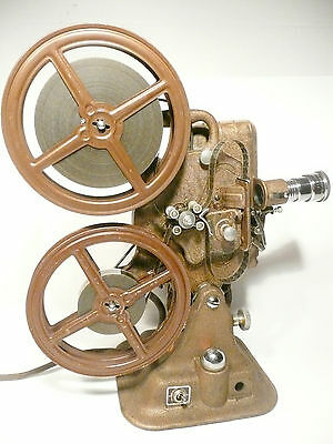 Working 16mm KEYSTONE A-81 MOVIE PROJECTOR w/ CARTOON - good picture/well built