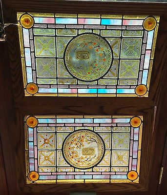 1 of a Matched pair of painted and fired stained glass windows