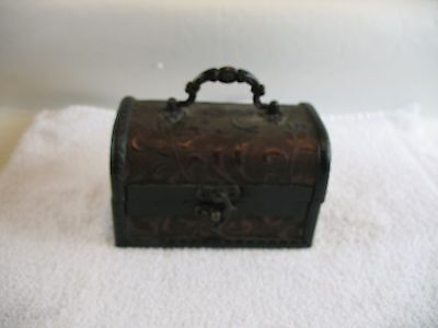 Wooden box with vinyl covering shaped like a chest